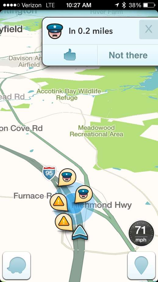 This image taken from the the Waze app on an iPhone, in Washington, shows police at the scene on a map on the app. A sheriffs' organization is broadening its concerns about the popular Waze mobile traffic app. Now it says a feature that lets drivers warn others about nearby police cruisers not only presents a threat to police safety from potential cop-killers, it also interferes with the ability to write speeding tickets.  (AP Photo/Ted Bridis) Photo: Ted Bridis, STF / AP