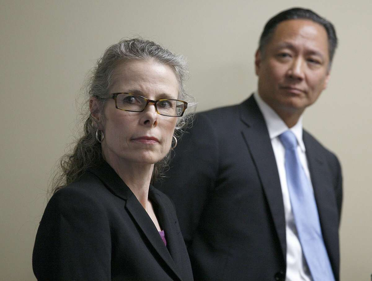 Attorney Jami Tillotson (left) watches video shown during a press conference with public defender Jeff Adachi (right) in San Francisco, Calif., on Wednesday, January 28, 2015. Attorney Jami Tillotson was arrested at the Hall of Justice at 850 Bryant St. for an hour yesterday while trying to question a client outside of the courtroom.