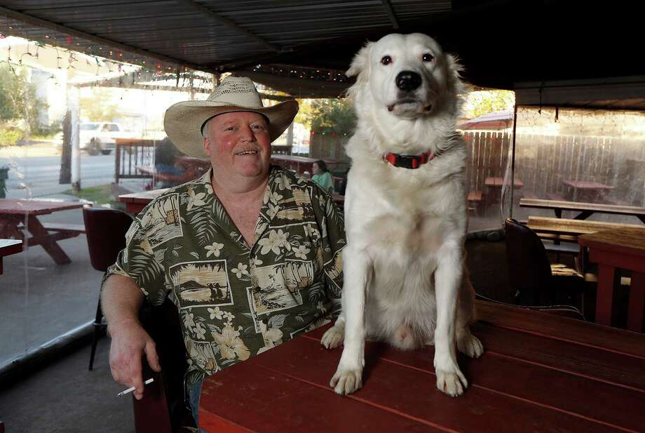 Blair Walker, manager of the West Alabama Ice House, and Togo. Photo: James Nielsen, Houston Chronicle / Houston Chronicle