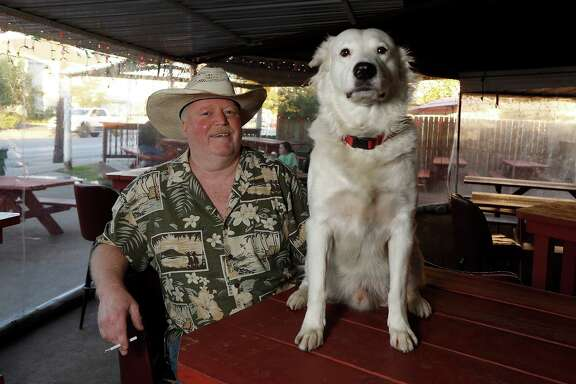 Blair Walker is the manager of the West Alabama Ice House. Walker is always at the Ice House with his dog, Togo.