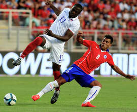 U.S. forward Jozy Altidore (left) battles with Chile's Gonzalo Espinoza during Wednesday's friendly.