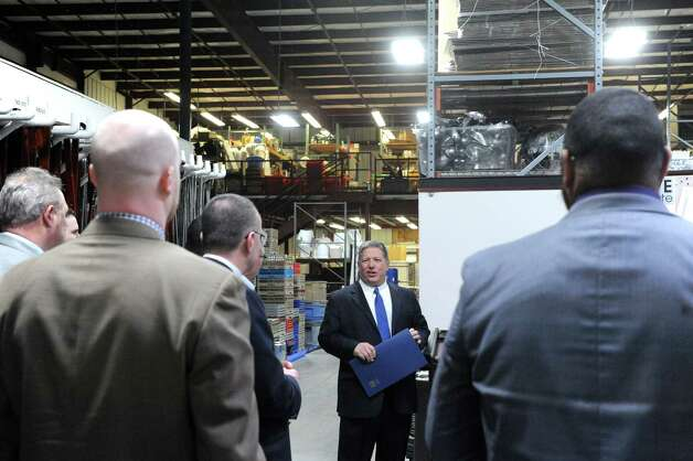 Angelo Mazzone, center, gives a guided tour during an unveiling of the new headquarters and catering center of Mazzone Hospitality on Wednesday Jan. 27, 2015 in Clifton Park , N.Y. (Michael P. Farrell/Times Union) Photo: Michael P. Farrell / 00030364A