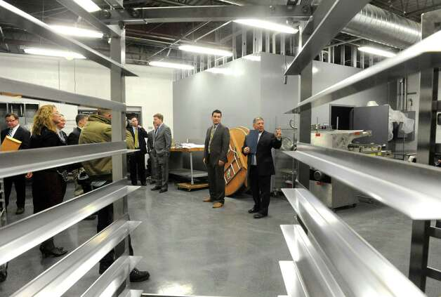 Angelo Mazzone, right, gives a guided tour during an unveiling of the new headquarters and catering center of Mazzone Hospitality on Wednesday Jan. 27, 2015 in Clifton Park , N.Y. (Michael P. Farrell/Times Union) Photo: Michael P. Farrell / 00030364A