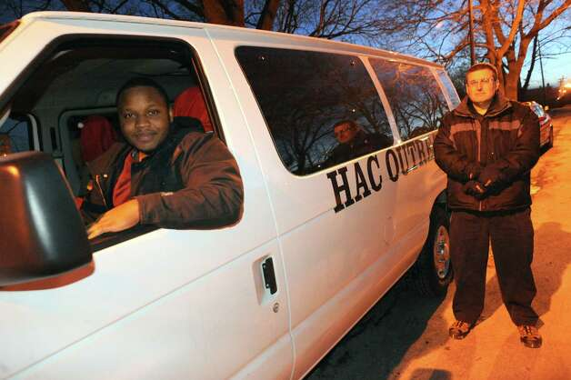 Driver Rolensky Alphonse, left, and volunteer Steve Gally set out for a night assisting the homeless with the outreach van on a Code Blue night Tuesday Jan. 20, 2015 in Albany, N.Y. (Michael P. Farrell/Times Union) Photo: Michael P. Farrell / 00030261A