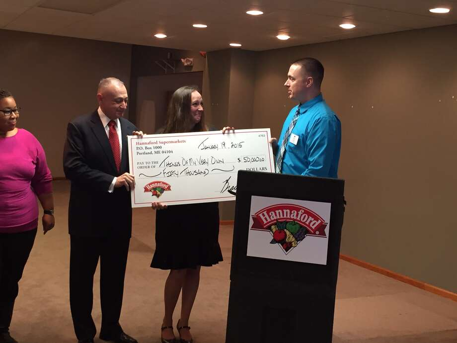 Hannaford Supermarkets Community Relations Specialist Brian Fabre, right, presents a $50,000 donation to Things of My Very Own CEO/Founder Rayn Boncie, center, and Board of Directors President Frank Graniero at the non-profit?s crisis prevention center in Schenectady on Monday, January 19. The donation underscores Hannaford?s support for Things of My Very Own, which has included assistance for services and programs it provides to children in at-risk situations. (Ed Lewis Associates photo)