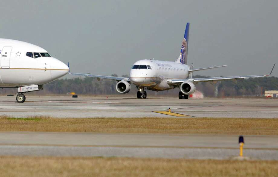 Taxiways at George Bush Intercontinental Airport began cracking months after they were completed by a Woodlands company. Photo: Billy Smith II, Staff / Houston Chronicle