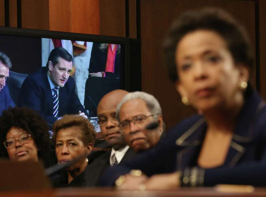A monitor shows Sen. Ted Cruz, R-Texas, as he questions Loretta Lynch, right, at Wednesday's hearing. Photo: Mark Wilson, Staff / 2015 Getty Images