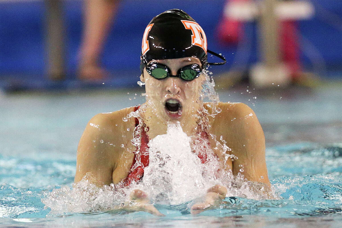 Elizabeth Holmes, swimming the breaststroke leg of the 200 individual medley she won, participated in three other victories Wednesday, two of them relays with her TMI teammates.