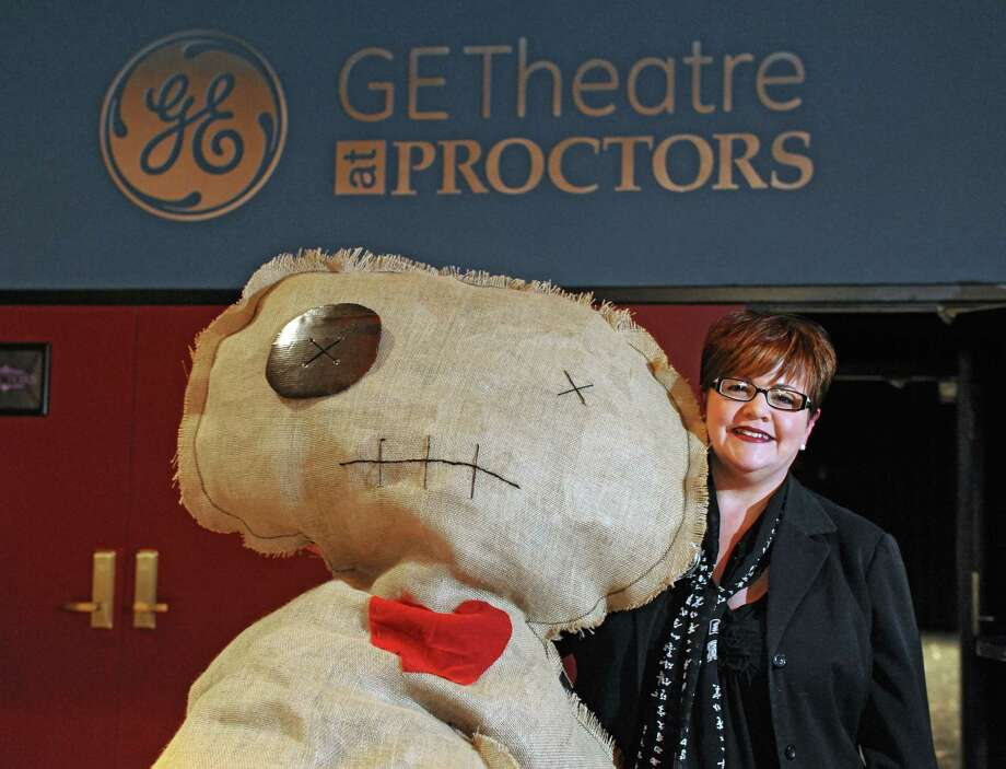 """Leesa Perazzo, special events manager for Proctor's, stands with Pat the voodoo doll at Proctor's Theatre on Wednesday, Jan. 28, 2015 in Schenectady, N.Y. Proctor's is holding a """"Love Bites"""" Valentine's Day event which will take place in the GE Theatre at Proctor's. (Lori Van Buren / Times Union) Photo: Lori Van Buren"""