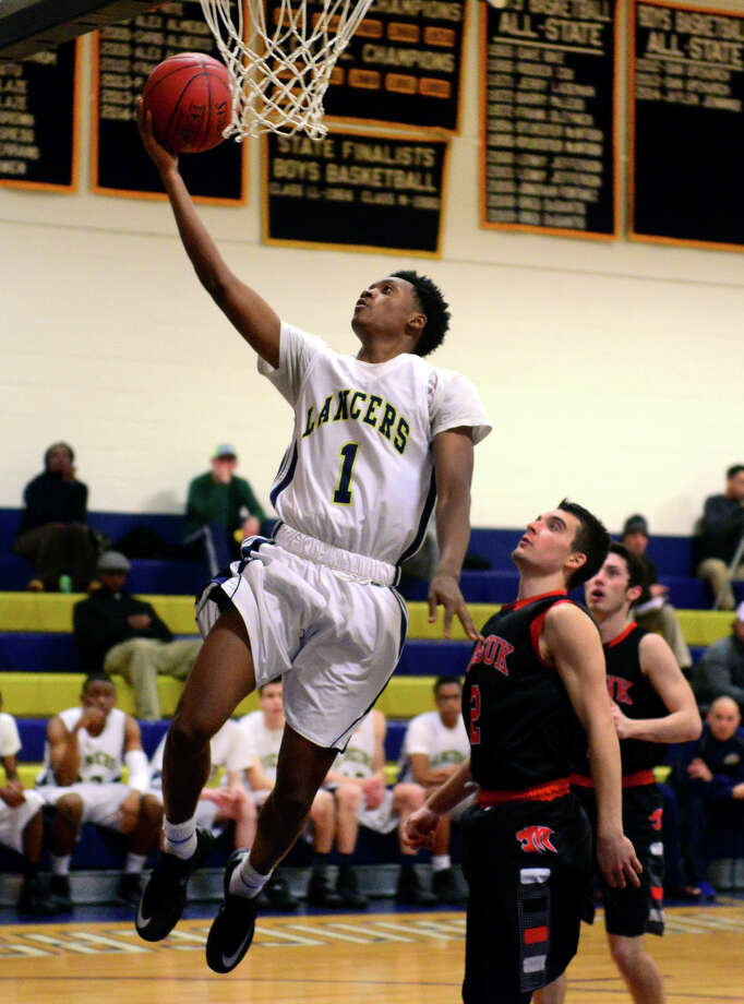Notre Dame of Fairfield's Jesse McIntosh lasys up for two, during boys basketball action against Masuk in Fairfield, Conn. on Wednesday Jan. 28, 2015. Photo: Christian Abraham / Connecticut Post
