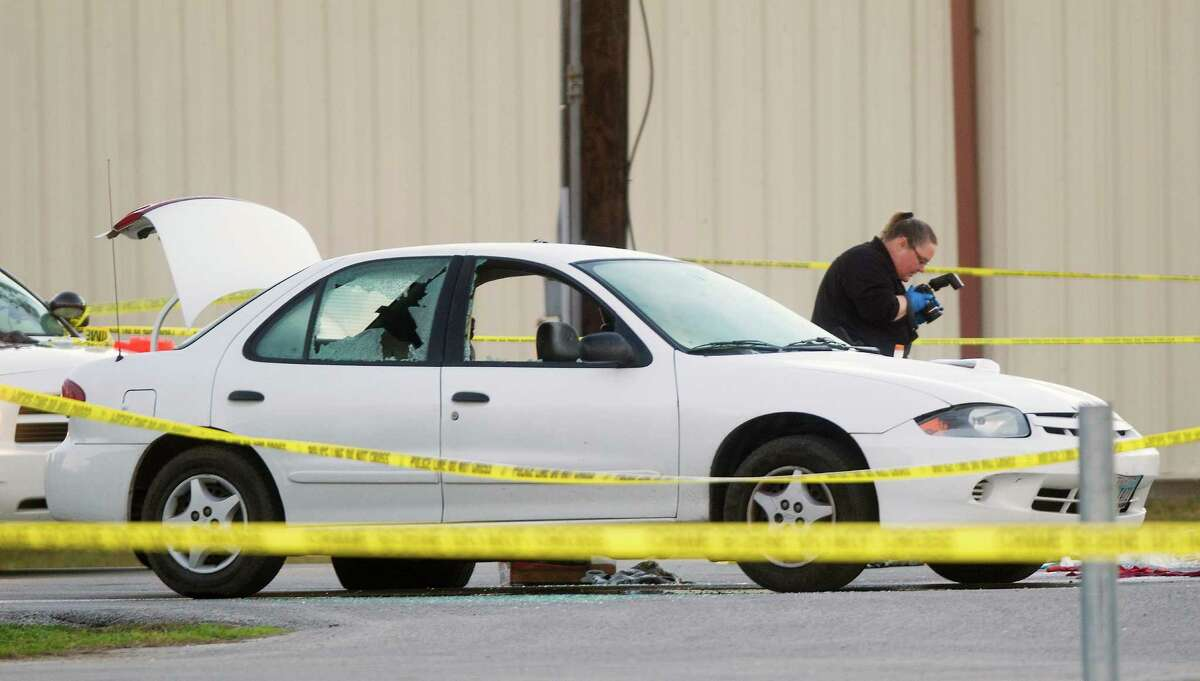 Rosenberg police document the scene of Wednesday's confrontation between officers and a shooting suspect.