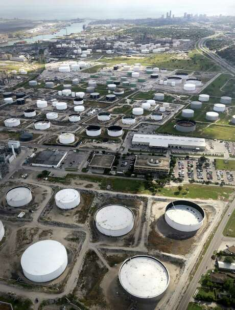 Oil storage tanks like these by Port Corpus Christi are filling up as crude prices decline. Photo: Bob Owen, Staff / ©2013 San Antonio Express-News