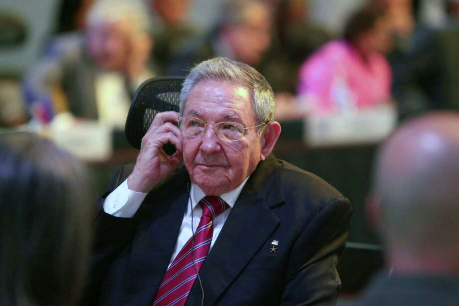 In this publicly distributed handout photo provided by the Presidency of the Republic of Costa Rica, Cuban President Raul Castro listens on a headphone to an intervention by a member state during the summit of the Community of Latin American and Caribbean States in San Jose, Costa Rica, Wednesday, Jan. 28, 2015. Castro demanded that the United States return the U.S. base at Guantanamo Bay, lift the half-century trade embargo on Cuba and compensate his country for damages before the two nations re-establish normal relations. (AP Photo/Presidency of the Republic of Costa Rica, Roberto Carlos Sanchez) Photo: Roberto Carlos Sanchez, HOPD / Presidency of the Republic of Co