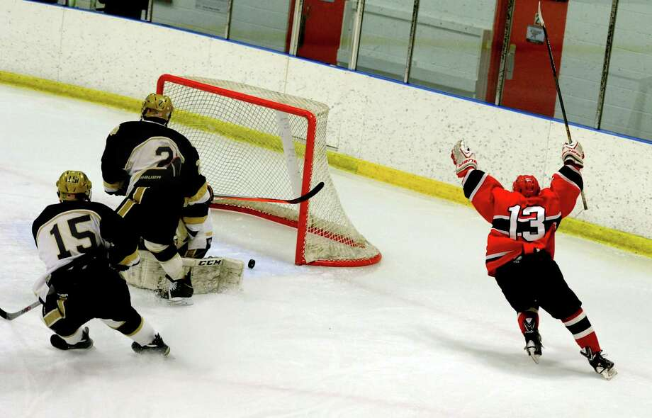 Greenwich's Kristian Cunningham scores against Notre Dame-Fairfield in boys hockey Wednesday, Jan. 28, 2015 at the Milford Ice Pavilion in Milford, Conn. Photo: Autumn Driscoll / Connecticut Post