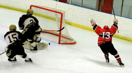 Greenwich's Kristian Cunningham scores against Notre Dame-Fairfield in boys hockey Wednesday, Jan. 28, 2015 at the Milford Ice Pavilion in Milford, Conn.