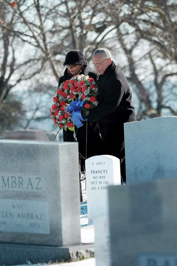 NASA chief Charles Bolden and his wife, Alexis, visit the graves of Apollo 1 astronauts Virgil Grissom and Roger Chaffee on NASA's Day of Remembrance at Arlington National Cemetery on Wednesday. Photo: T.J. Kirkpatrick, Stringer / 2015 Getty Images