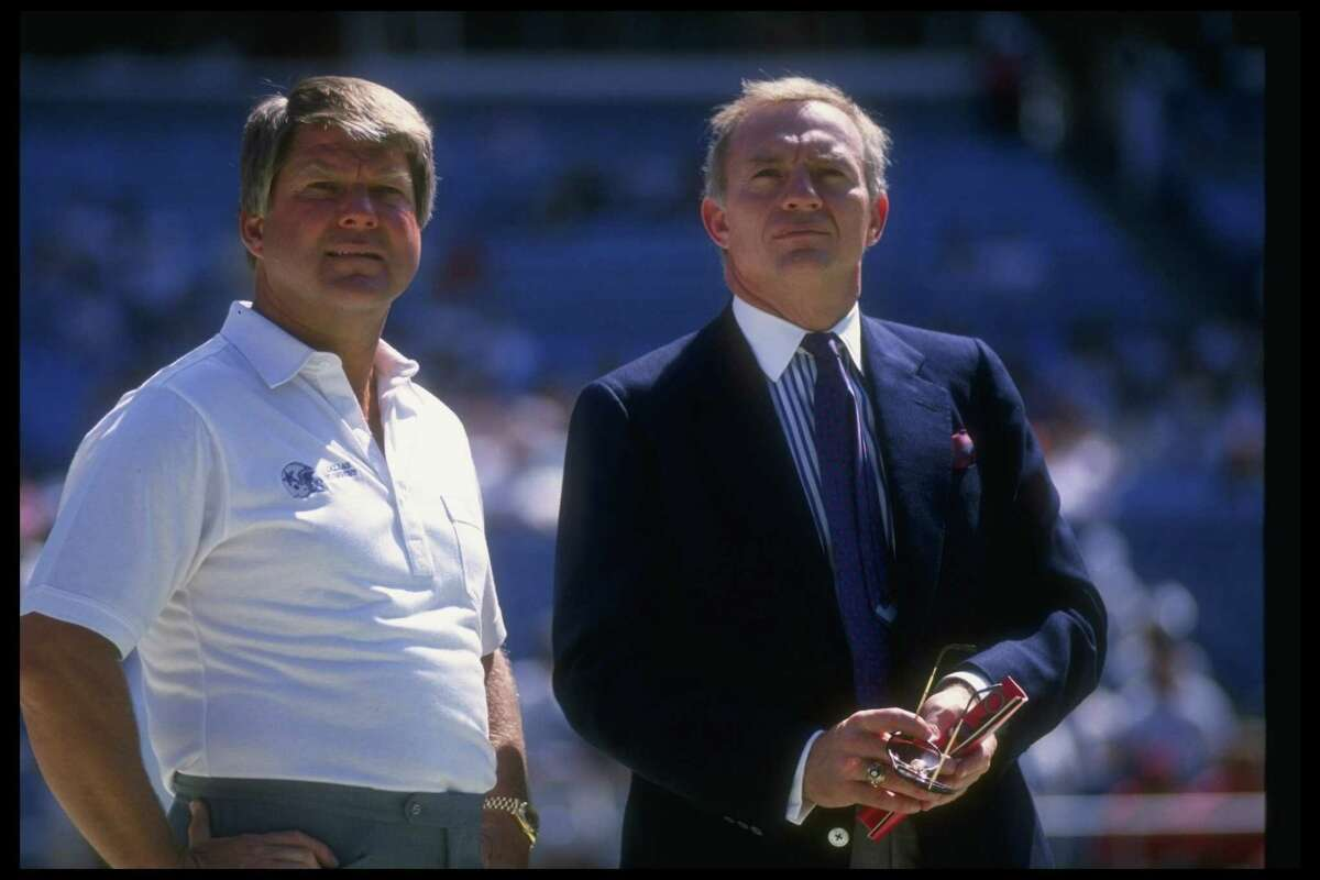 Dallas Cowboys head coach Jimmy Johnson (left) and owner Jerry Jones look on during a game against the Atlanta Falcons at Fulton County Stadium in Atlanta on Sept. 17, 1989.