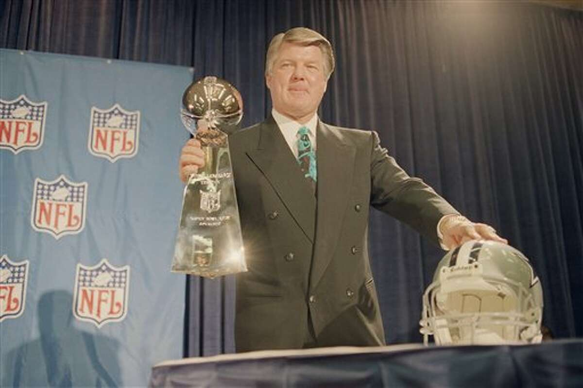 Cowboys coach Jimmy Johnson holds up the Super Bowl trophy following a news conference in Atlanta on Jan. 28, 1994.