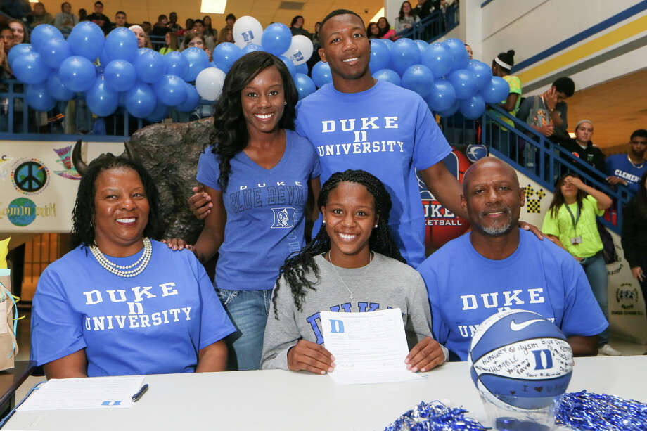 Kyra Lambert of Clemens signs a letter of intent to play basketball for Duke at the high School on Nov. 12, 2014. With Lambert are her mother, Barna Lambert (from left), sister Lynn Lambert, brother Eric Lambert and father Agapito Lambert. Photo: Marvin Pfeiffer /San Antonio Express-News / San Antonio Express-News 2014