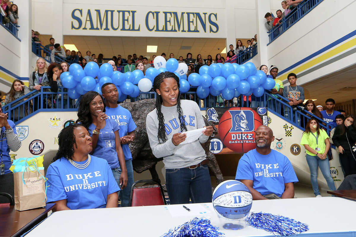 Clemens basketball star Kyra Lambert (center) thanks everyone for their support prior to signing a letter of intent to play basketball for Duke.