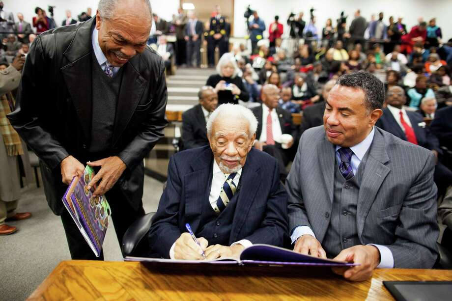 Ernest Finney, a former South Carolina Supreme Court justice, signs a book about the Friendship 9 before a hearing exonerating the men of 1961 violations. Photo: MEGAN GIELOW, STR / NYTNS