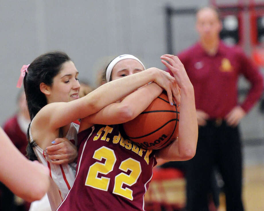 At left, Leigh Galletta (#4) of Greenwich grabs a loose ball along with Shannon O'Meara (#22) of St. Joseph during the girls high school basketball game between Greenwich High School and St. Joseph High School at Greenwich, Conn., Wednesday night, Jan. 28, 2015 Photo: Bob Luckey / Greenwich Time