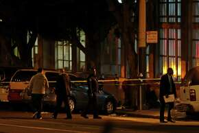 San Francisco police investigate the scene where a suitcase full of body parts was found on 11th Street near Mission Street on Wednesday.