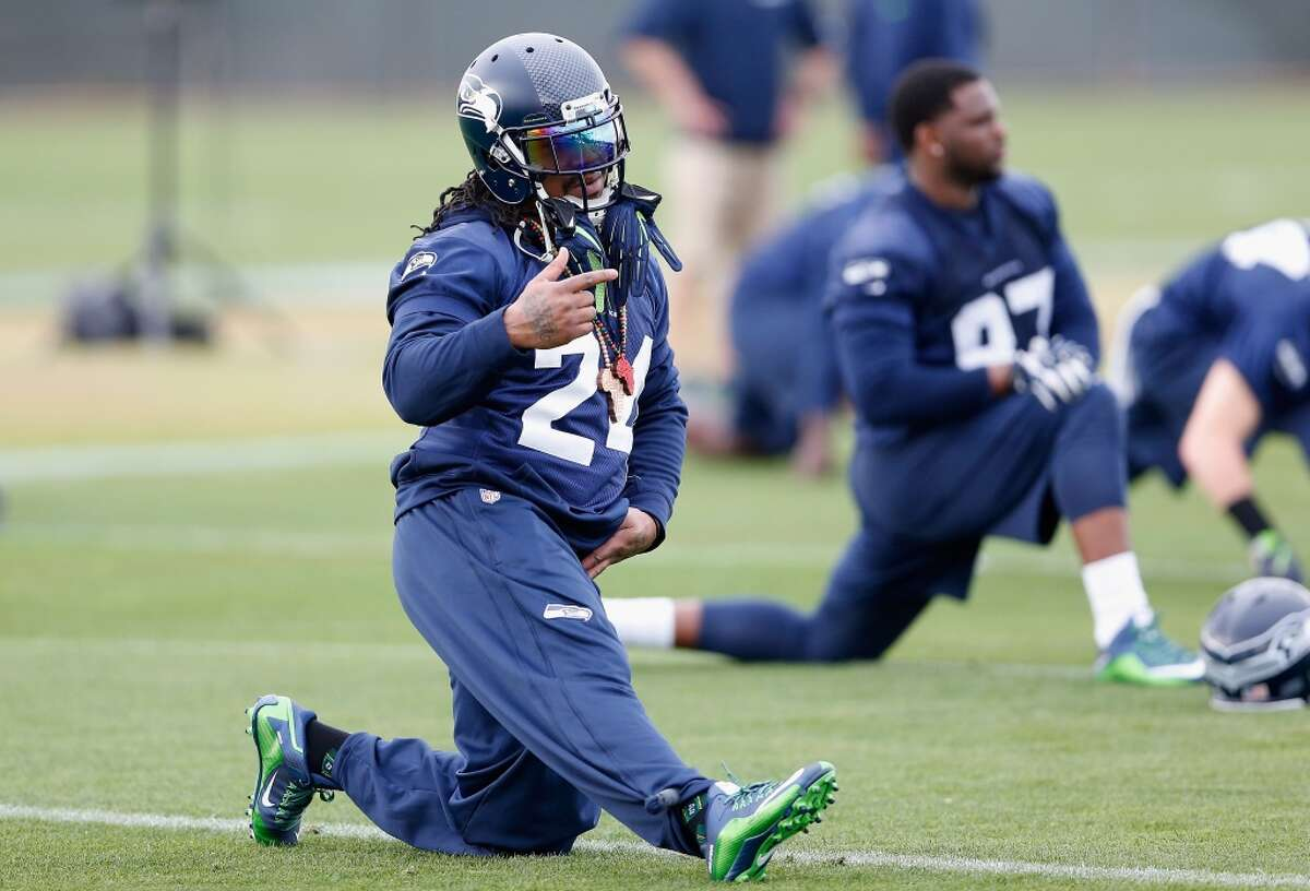 TEMPE, AZ - JANUARY 28: Running back Marshawn Lynch #24 of the Seattle Seahawks stretches during a practice at Arizona State University on January 28, 2015 in Tempe, Arizona. (Photo by Christian Petersen/Getty Images)