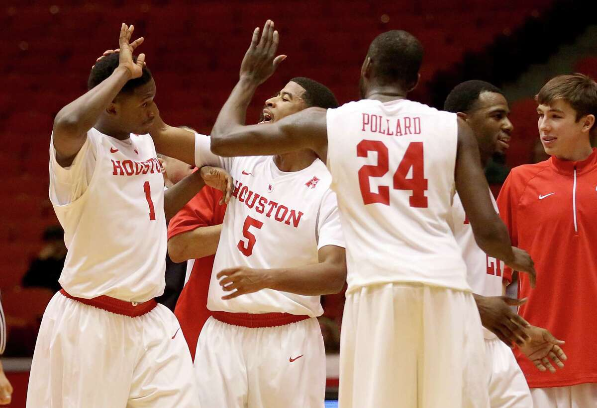 Houston Cougars forward Mikhail McLean (1), guard L.J. Rose (5) and forward Devonta Pollard (24) celebrate against the Rice Owls in the second half in a NCAA basketball game on Wednesday, January 28, 2015 at Hofheinz Pavilion in Houston, TX. UH won 59 to 48 .