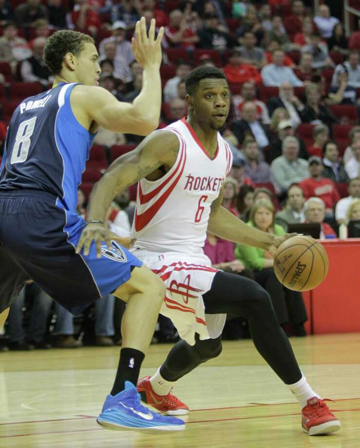 Rockets Terrence Jones takes the ball around Mavericks Dwight Powell during the first half of NBA game at Toyota Center Wednesday, Jan. 28, 2015, in Houston. Photo: Melissa Phillip, Houston Chronicle / © 2014  Houston Chronicle