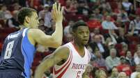 Rockets Terrence Jones takes the ball around Mavericks Dwight Powell during the first half of NBA game at Toyota Center Wednesday, Jan. 28, 2015, in Houston.