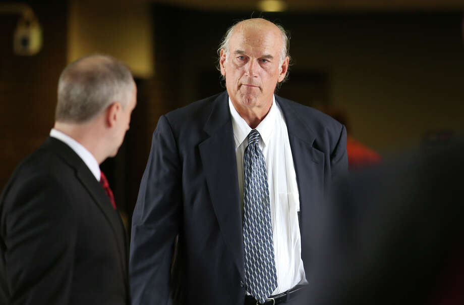 """FILE - In this July 8, 2014 file photo, former Navy SEAL and Minnesota Gov. Jesse Ventura, right, walks into Warren E. Burger Federal Building during the first day of jury selection in a defamation lawsuit in St. Paul, Minn. Ventura, who won $1.8 million in the lawsuit against the estate of the late Chris Kyle, says he won't see the film partly because Kyle is no hero to him. He tells The Associated Press a hero must be honorable, and there' no honor in lying. Lyle claimed in his """"American Sniper"""" book that he punched out a man, whom he later identified as Ventura, at a California bar in 2006 for allegedly saying the SEALs """"deserve to lose a few"""" in Iraq. Ventura said it never happened.  (AP Photo/The Star Tribune, Elizabeth Flores)  MANDATORY CREDIT; ST. PAUL PIONEER PRESS OUT; MAGS OUT; TWIN CITIES LOCAL TELEVISION OUT ORG XMIT: MNMIT501 Photo: Elizabeth Flores / The Star Tribune"""
