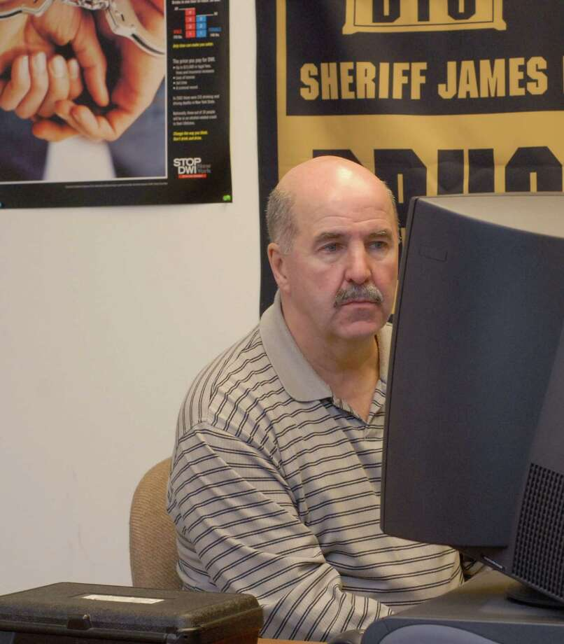 Albany County Sheriffs Department, Inspector John Burke works at a computer  at the Albany County Sheriffs Department in Cohoes, N.Y.,  Tuesday, Jan. 8, 2008. (Paul Buckowski / Times Union archive) Photo: Paul Buckowski / Albany Times Union