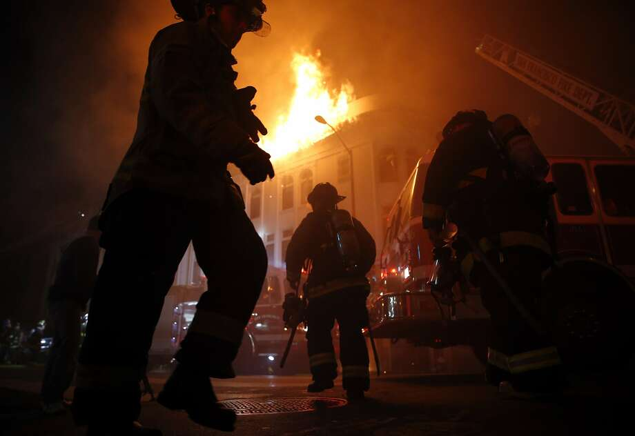 San Francisco Fire Department members fight blaze at 22nd and Mission Street in San Francisco, Calif., on Wednesday, January 28, 2015. Photo: Scott Strazzante, The Chronicle