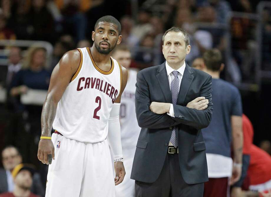 Cleveland Cavaliers head coach David Blatt talks with Kyrie Irving (2) during an NBA basketball game against the Charlotte Hornets Friday, Jan. 23, 2015, in Cleveland. (AP Photo/Mark Duncan) Photo: Mark Duncan, STF / AP