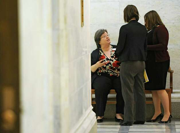 Assembly member Cathy Nolan, left, chats with a couple women while Assembly members are deciding on the fate of Speaker Sheldon Silver Monday, Jan. 26, 2015 in Albany, N.Y. (Lori Van Buren / Times Union) Photo: Lori Van Buren