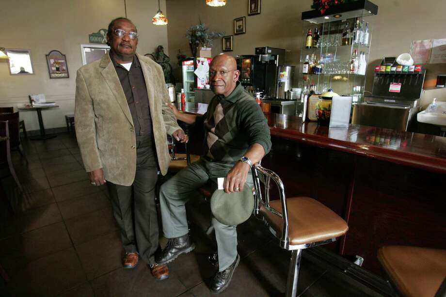 """FILE - In this March 5, 2009, file photo, the Rev. W. T.  """"Dub"""" Massey, right, and Willie McLeod, left, pose at the counter where they were among the """"Friendship Nine"""" who were jailed during 1960s civil rights """"sit-ins"""" at what is now called the Old Town Bistro in Rock Hill, S.C.  A prosecutor on Wednesday, Jan. 28, 2015, is expected to ask a judge to vacate the arrests and convictions of the eight Friendship Junior College students and a civil rights organizer. (AP Photo/Mary Ann Chastain, File) ORG XMIT: GARV201 Photo: Mary Ann Chastain / AP"""