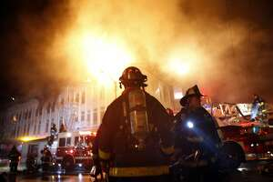 Firefighters dousing hotspots at scene of fatal Mission District fire - Photo