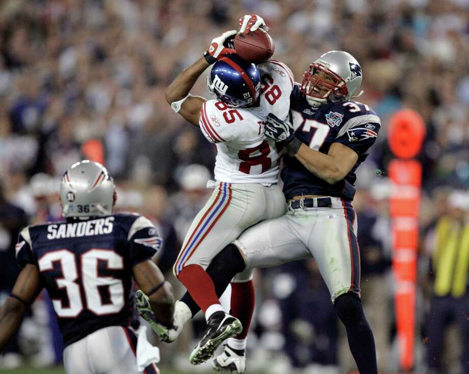 FILE - In this Feb. 3, 2008, file photo, New York Giants receiver David Tyree (85) catches a pass while in the clutches of New England Patriots safety Rodney Harrison (37) as James Sanders (36) watches during the fourth quarter of the Super Bowl XLII football game in Glendale, Ariz. A win Sunday night, Feb 1, against the Seattle Seahawks would even the Patriots record in Super Bowls at University of Phoenix Stadium at 1-1. New England is seeking a championship, not closure for its 17-14 loss to the New York Giants in 2008. (AP Photo/Gene Puskar, File) ORG XMIT: NY181 Photo: Gene Puskar / AP