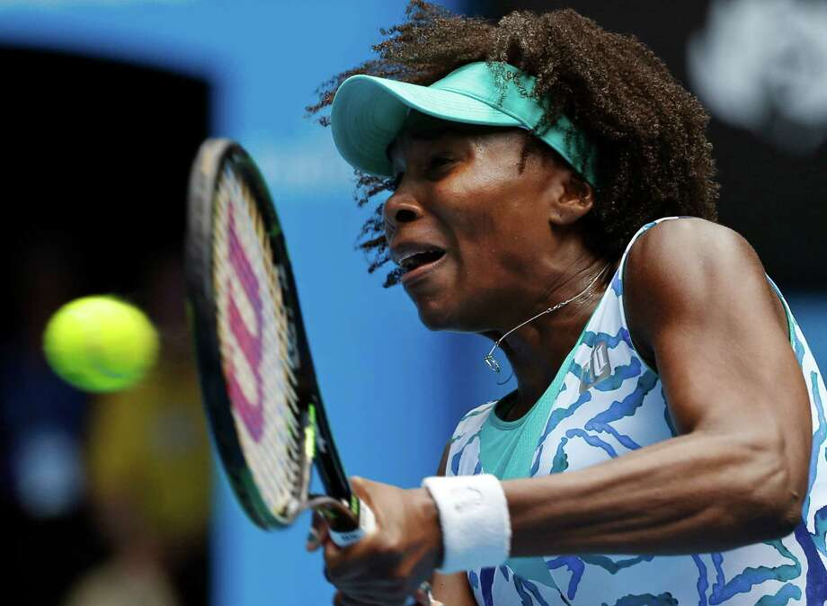 Venus Williams of the U.S. makes a backhand return to her compatriot Madison Keys during their quarterfinal match at the Australian Open tennis championship in Melbourne, Australia, Wednesday, Jan. 28, 2015. (AP Photo/Vincent Thian) ORG XMIT: MEL130 Photo: Vincent Thian / AP