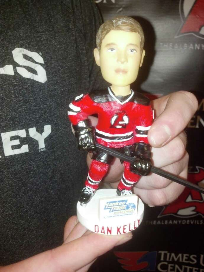 Dan Kelly of the Albany Devils displays a bobblehead featuring his likeness, which will be given away at their game against St. John's on Saturday night at Times Union Center. (Pete Dougherty / Times Union)