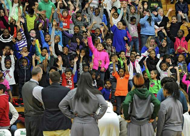 Students scream for a t-shirt to be thrown to them while they watch the Siena women's basketball team take on Rider University during the fifth annual BlueShield of Northeastern New York Kids Day Game on Wednesday, Jan. 28, 2015 in Loudonville, N.Y. Nearly 2,000 local children and teachers from nine Capital Region schools came to watch the game. (Lori Van Buren / Times Union) Photo: Lori Van Buren / 00030366A