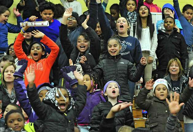 Students from Lincoln Community School in Schenectady watch the Siena women's basketball team take on Rider University during the fifth annual BlueShield of Northeastern New York Kids Day Game on Wednesday, Jan. 28, 2015 in Loudonville, N.Y. Nearly 2,000 local children and teachers from nine Capital Region schools came to watch the game. (Lori Van Buren / Times Union) Photo: Lori Van Buren / 00030366A