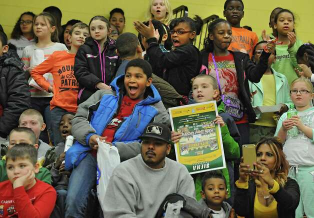Students from the Zoller Elementary and Middle School of Schenectady watch the Siena women's basketball team take on Rider University during the fifth annual BlueShield of Northeastern New York Kids Day Game on Wednesday, Jan. 28, 2015 in Loudonville, N.Y. Nearly 2,000 local children and teachers from nine Capital Region schools came to watch the game. (Lori Van Buren / Times Union) Photo: Lori Van Buren / 00030366A