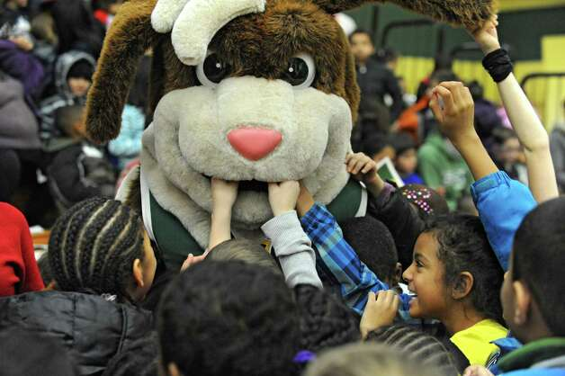 Students have fun with Bernie the Saint Bernard mascot while they watch the Siena women's basketball team take on Rider University during the fifth annual BlueShield of Northeastern New York Kids Day Game on Wednesday, Jan. 28, 2015 in Loudonville, N.Y. Nearly 2,000 local children and teachers from nine Capital Region schools came to watch the game. (Lori Van Buren / Times Union) Photo: Lori Van Buren / 00030366A