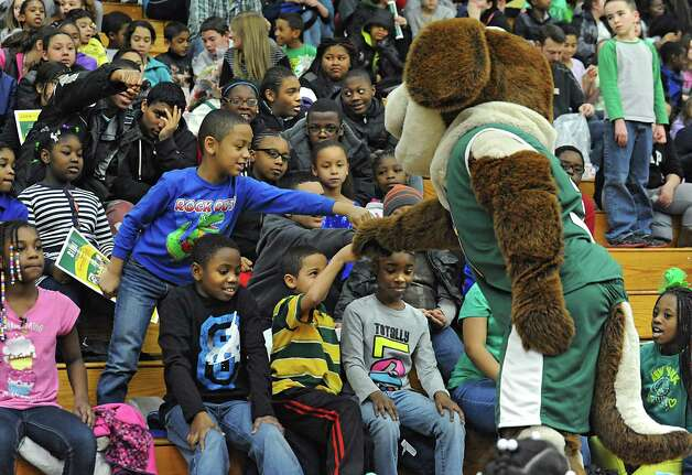 Students fist bump Bernie the Saint Bernard mascot while they watch the Siena women's basketball team take on Rider University during the fifth annual BlueShield of Northeastern New York Kids Day Game on Wednesday, Jan. 28, 2015 in Loudonville, N.Y. Nearly 2,000 local children and teachers from nine Capital Region schools came to watch the game. (Lori Van Buren / Times Union) Photo: Lori Van Buren / 00030366A