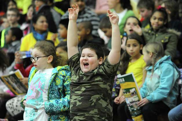 Tyler Lownsbury, 9, of Zoller Elementary School of Schenectady screams while he watches the Siena women's basketball team take on Rider University during the fifth annual BlueShield of Northeastern New York Kids Day Game on Wednesday, Jan. 28, 2015 in Loudonville, N.Y. Nearly 2,000 local children and teachers from nine Capital Region schools came to watch the game. (Lori Van Buren / Times Union) Photo: Lori Van Buren / 00030366A
