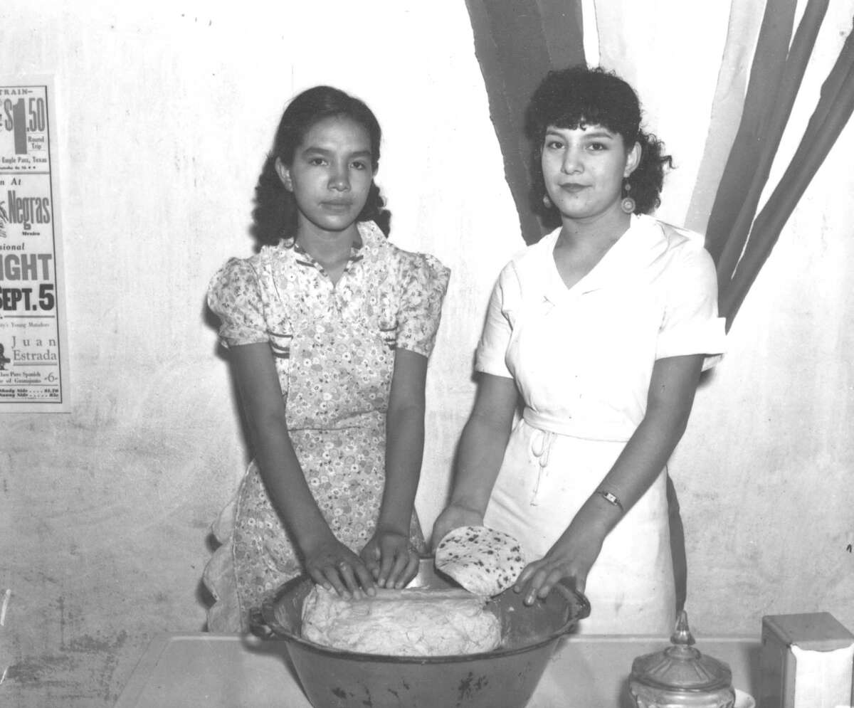 Juanita and Esperanza Garcia worked in their indoor cafe in 1937. The Garcias and their mother were among the best of the Chili Queens forced to close their stands in Haymarket Plaza.