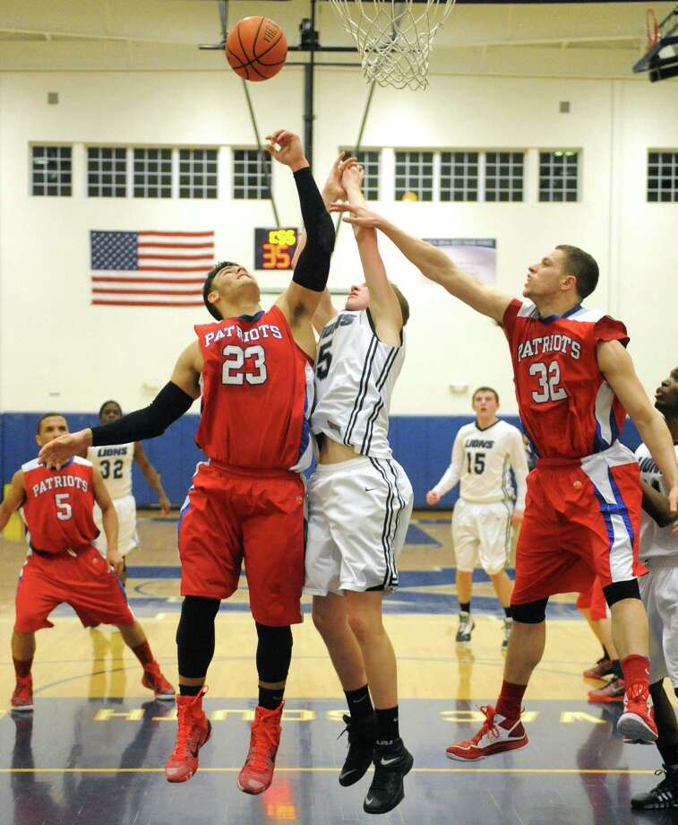 Mekeel's Carter Stewart battles Broadalbin-Perth's Vincenzo Dicaterino, left, and Chris Natoli, right, for a rebound during their boy's high school basketball game on Wednesday Jan. 27, 2015 in Scotia , N.Y. (Michael P. Farrell/Times Union) Photo: Michael P. Farrell / 00030367A