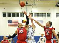 Mekeel's Carter Stewart battles Broadalbin-Perth's Vincenzo Dicaterino, left, and Chris Natoli, right, for a rebound during their boy's high school basketball game on Wednesday Jan. 27, 2015 in Scotia , N.Y. (Michael P. Farrell/Times Union)
